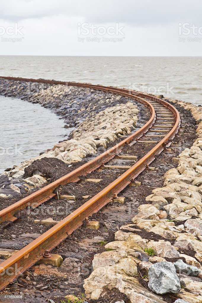 railroad into the sea stock photo