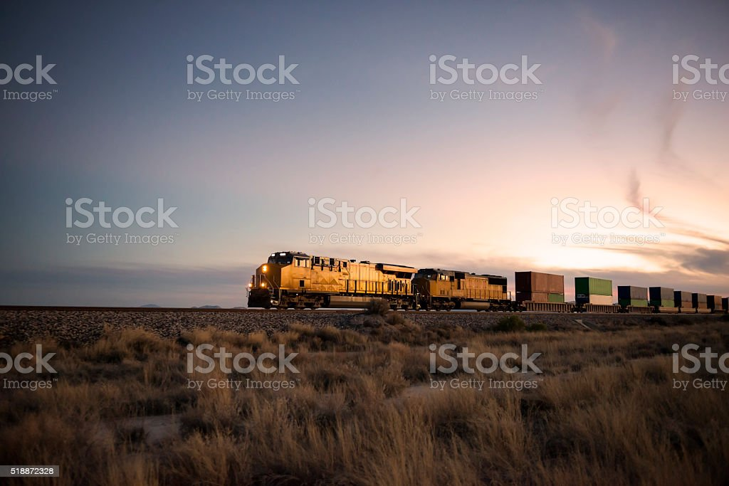 Railroad locomotive at dusk stock photo
