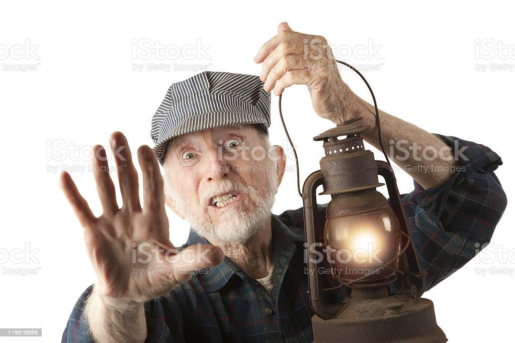 Railroad man holding lantern stock photo