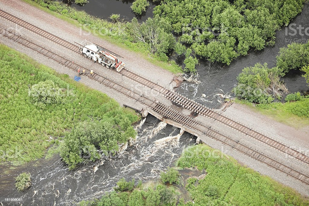 Railroad Repair at Washed Out Bridge Site stock photo