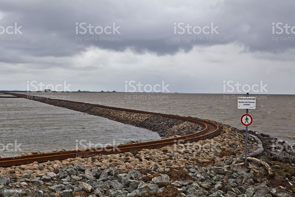 railroad through the sea stock photo