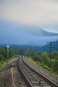Railroad track and distant mountains seen