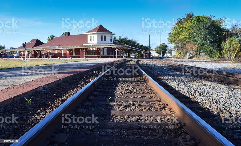 Railroad Track and Train Station stock photo