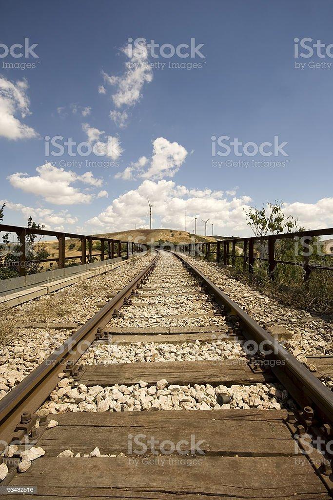 Railroad track and wind turbine royalty-free stock photo