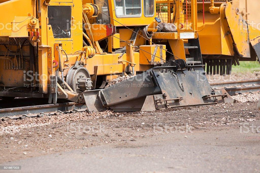 Railroad Track Construction Ballast Regulator/Compactor Machine royalty-free stock photo