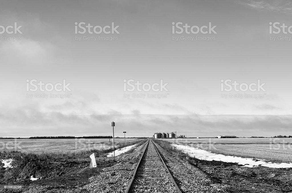 Railroad track in black and white landscape stock photo