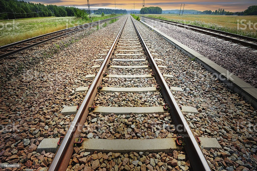 Railroad track in the evening royalty-free stock photo