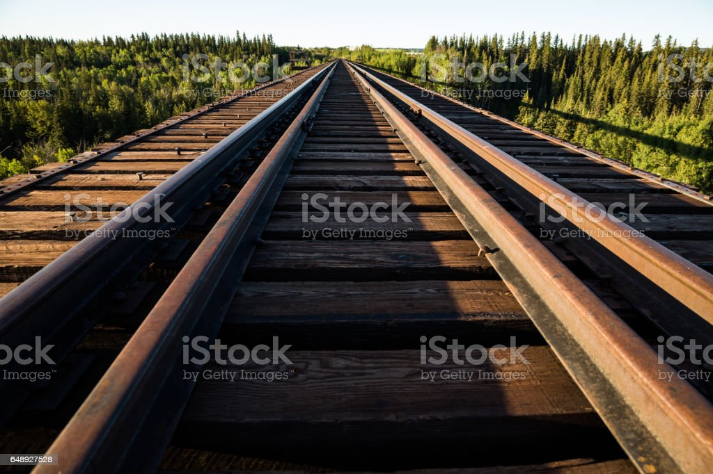 Railroad track over abandoned railroad trestle stock photo