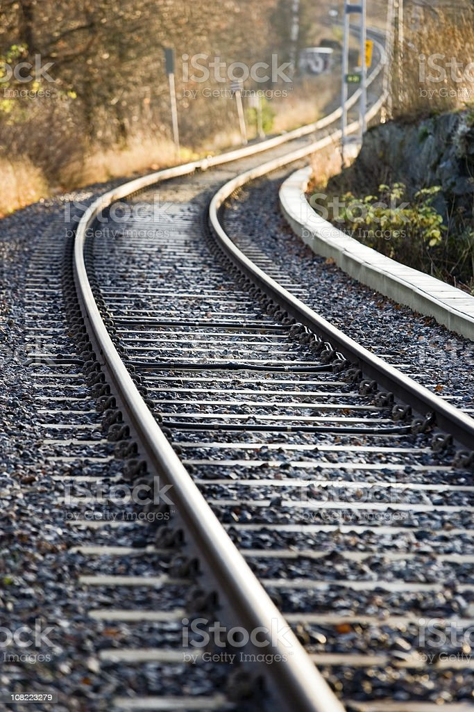 Railroad track with curves royalty-free stock photo