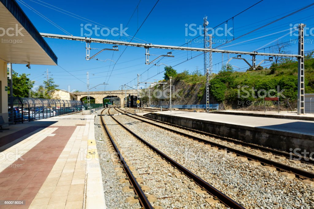 Railroad track with vanishing point at a train station stock photo