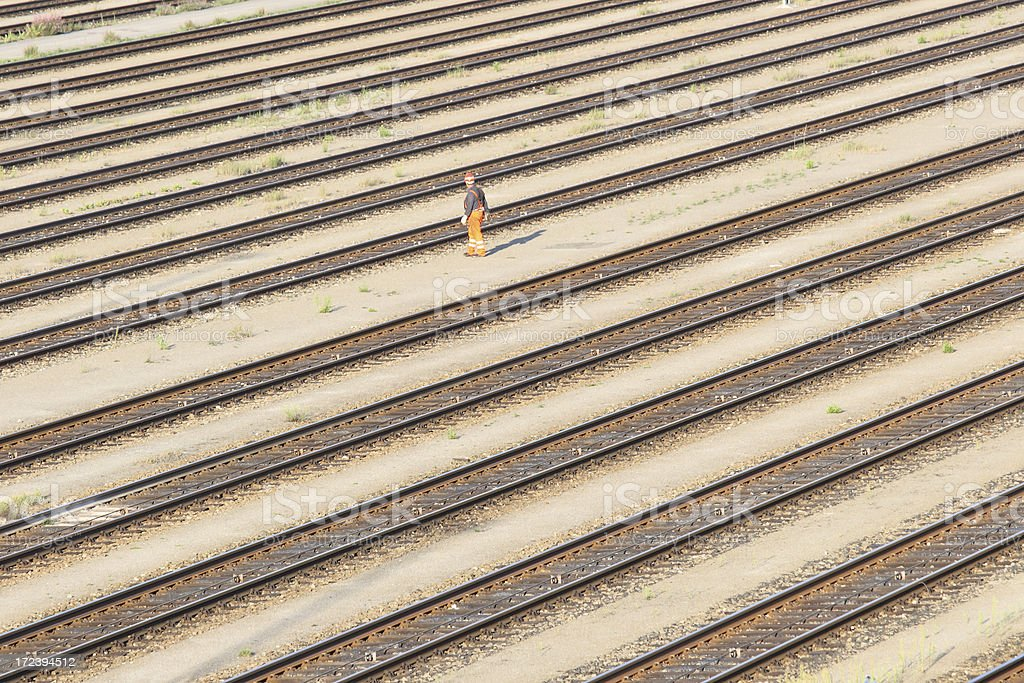 Railroad Tracks and Worker stock photo