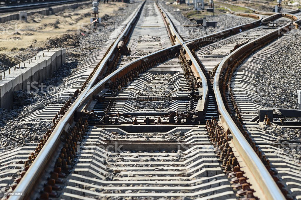 Railroad tracks at the train station stock photo