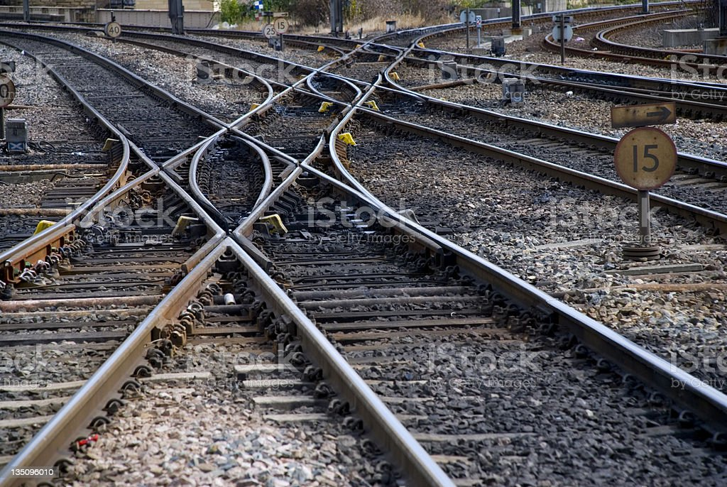 Railroad tracks crossing over each other stock photo