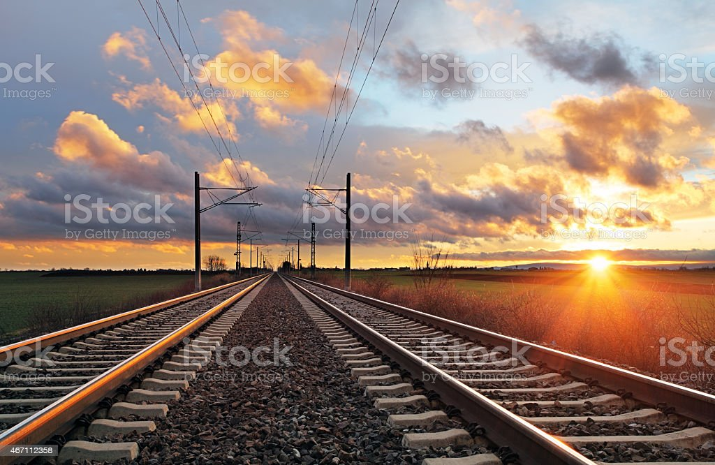 Railroad tracks during the sunset stock photo