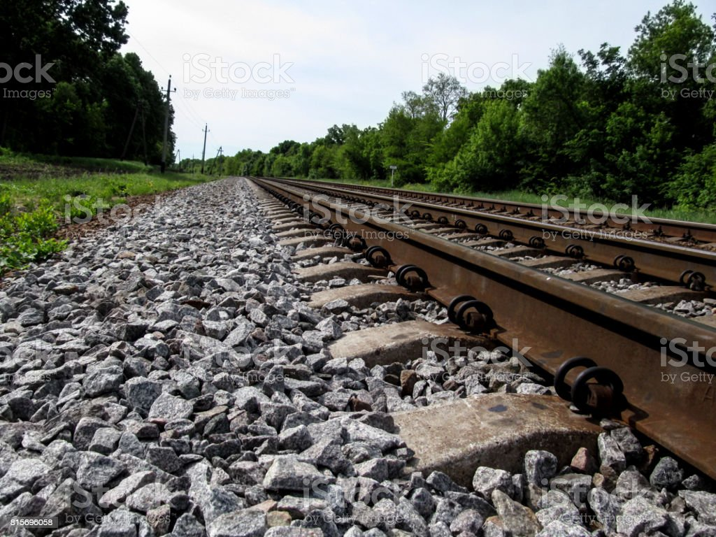Railroad tracks go to the horizon, close-up stock photo