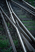 Railroad tracks in black background with grass