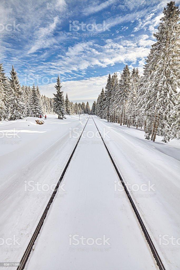Railroad tracks in snow, winter landscape stock photo