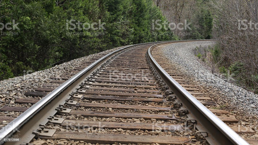 railroad tracks on a curve stock photo