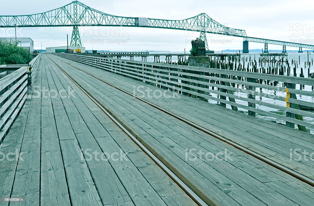 Railroad tracks on pier in industrial area of Astoria OR stock photo