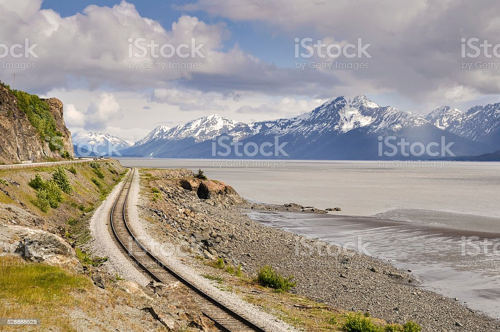 Railroad tracks running through Turnagain Arm, Alaska stock photo