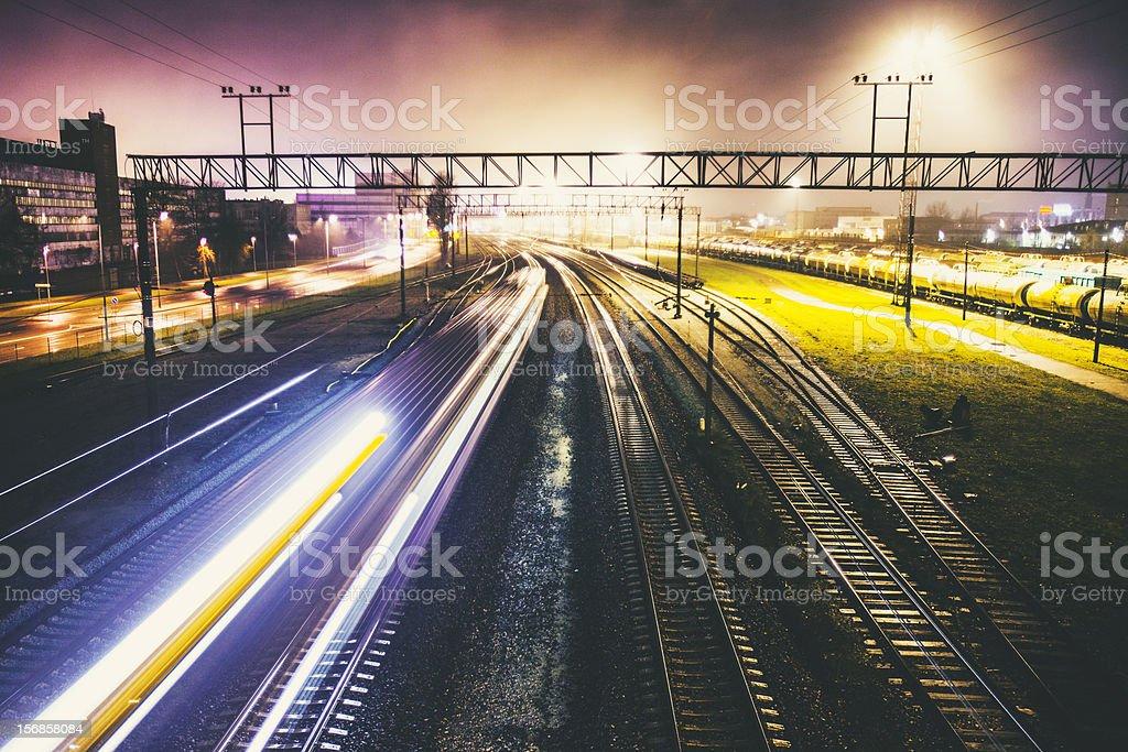 Railroad traffic by night. stock photo