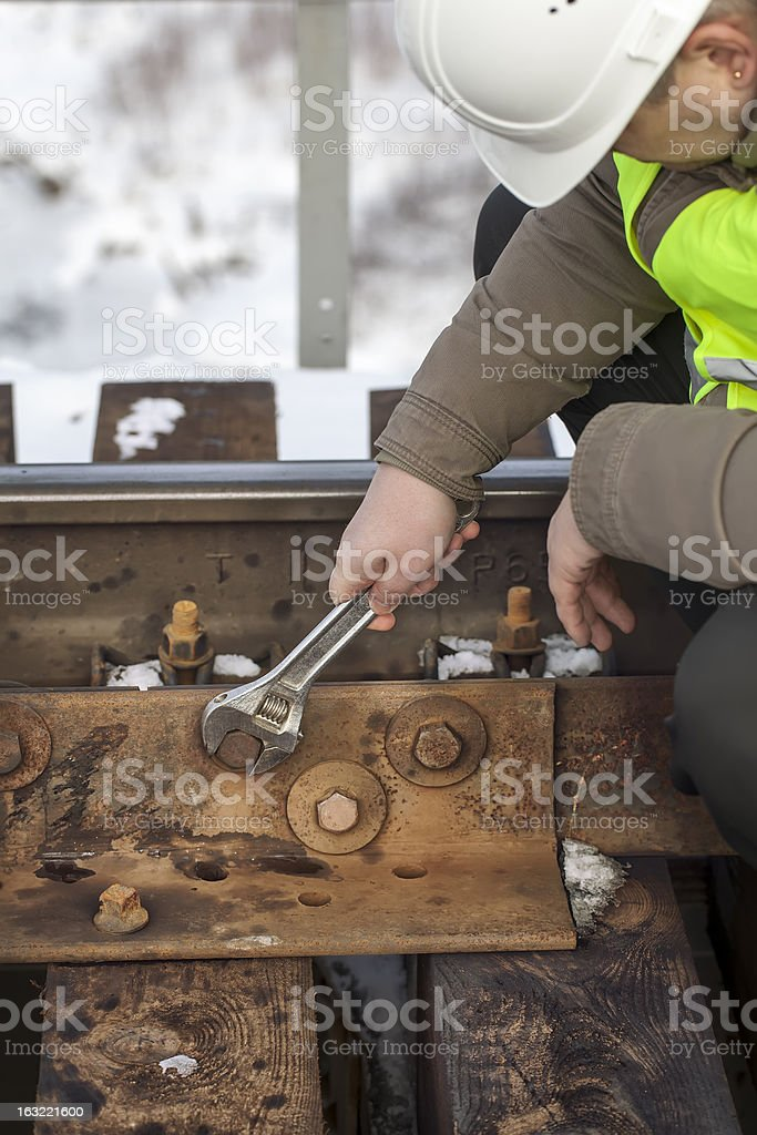 Railroad worker with wrench royalty-free stock photo