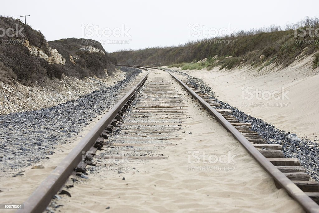 rails in the dunes stock photo