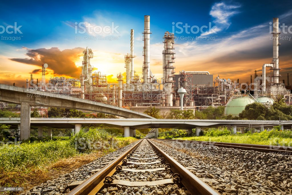 Railway and road to refinery stock photo