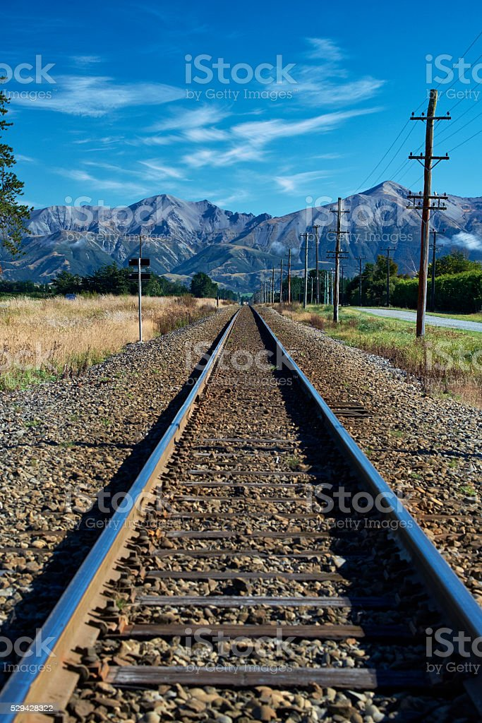 Railway And The Southern Alps stock photo