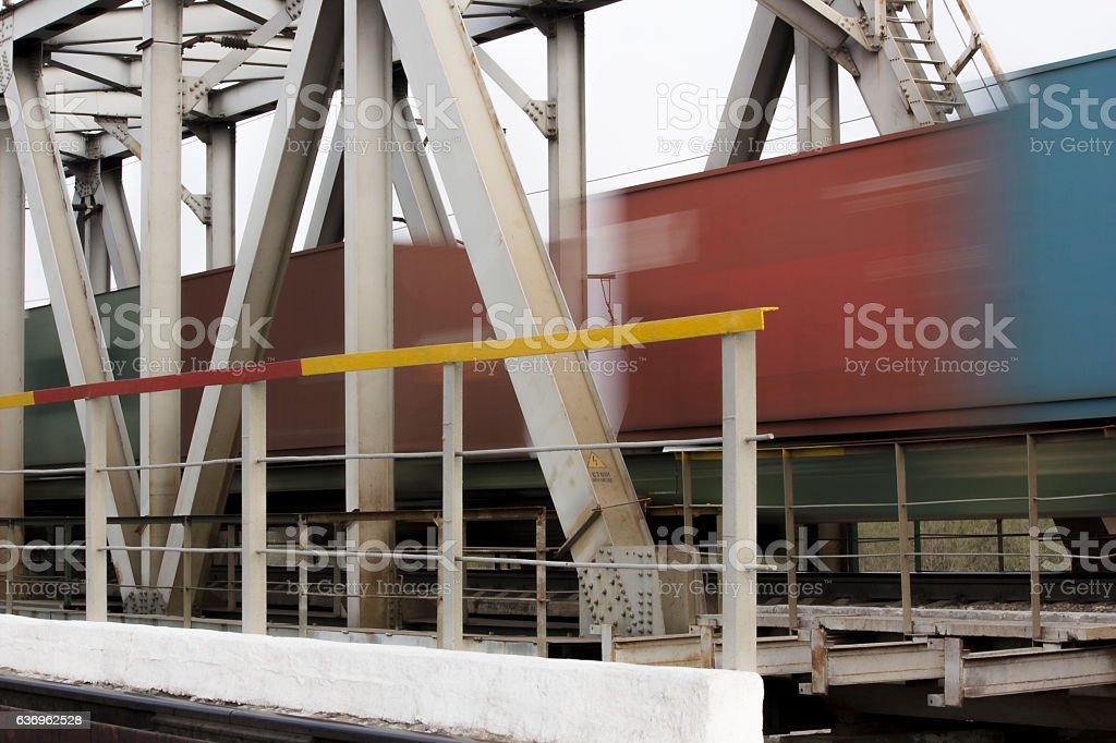 Railway bridge close-up and a moving train stock photo