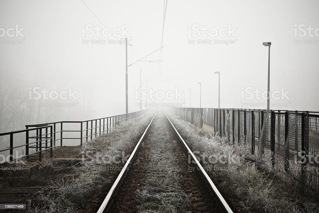 Railway bridge in fog royalty-free stock photo