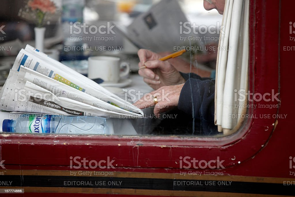 Railway carriage restaurant car passenger doing crossword royalty-free stock photo