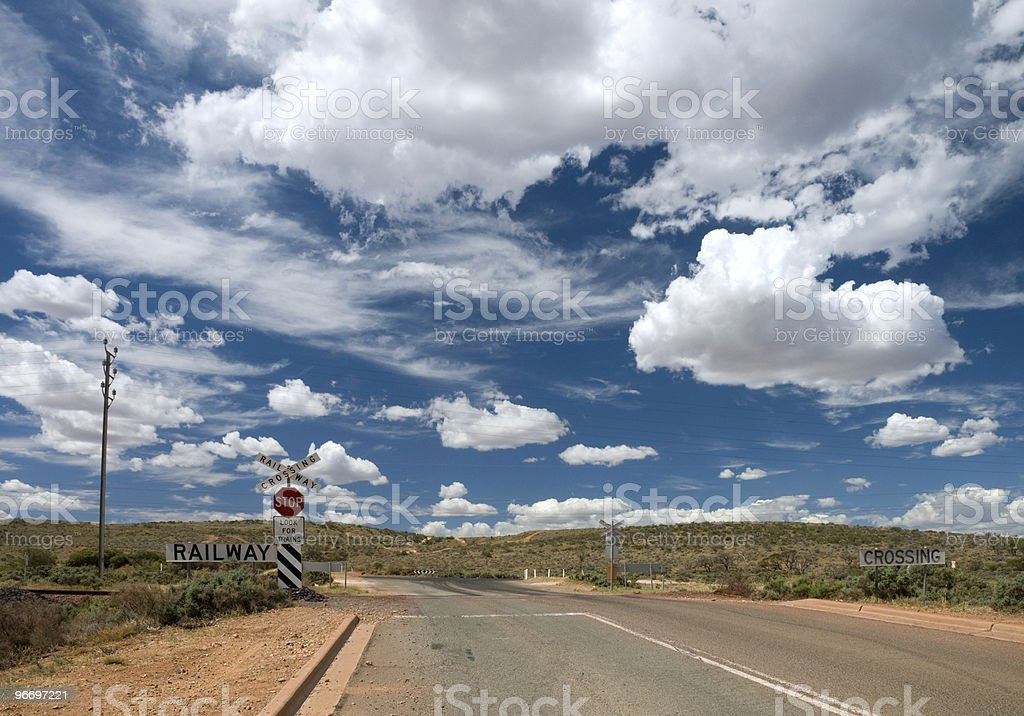 Railway Crossing and clouds stock photo