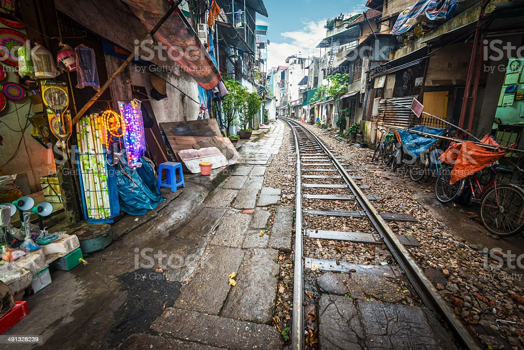 Railway crossing the street in city, Vietnam. stock photo