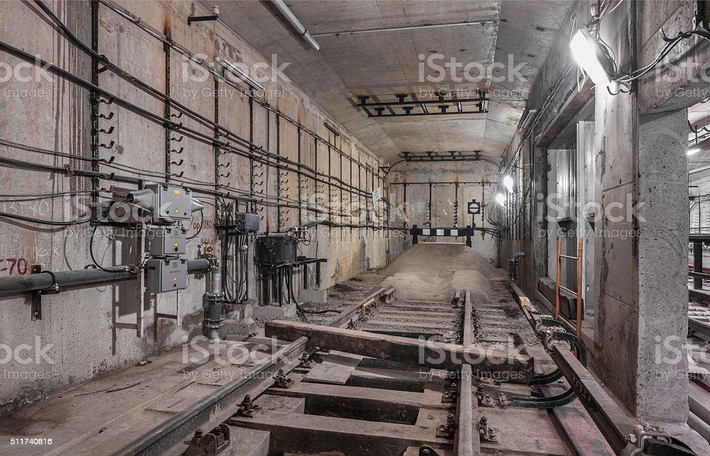 Railway deadlock in the tunnel subway stock photo