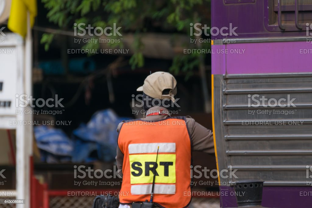 railway employees controlling the locomotive for switching the railway before serving at State Railway of Thailand. stock photo