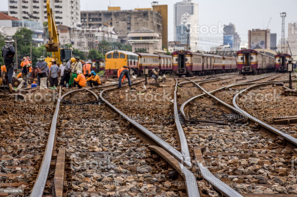 Railway employees working for restoration the railroad tracks before serving at State Railway of Thailand. stock photo