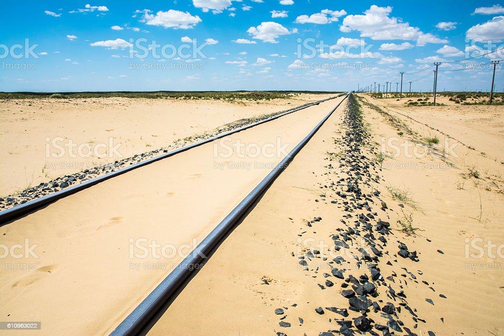 Railway in the desert of Aral stock photo