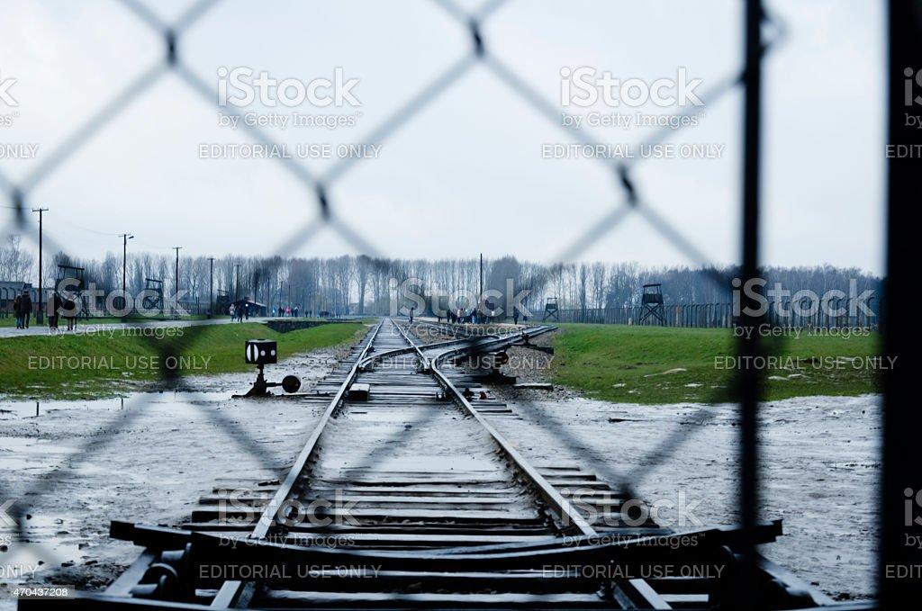 Railway line arriving into camp Auschwitz II; Birkenau in Poland stock photo