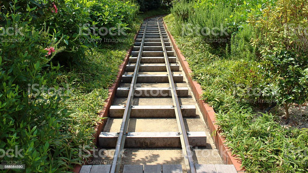 Railway line running between the green stock photo