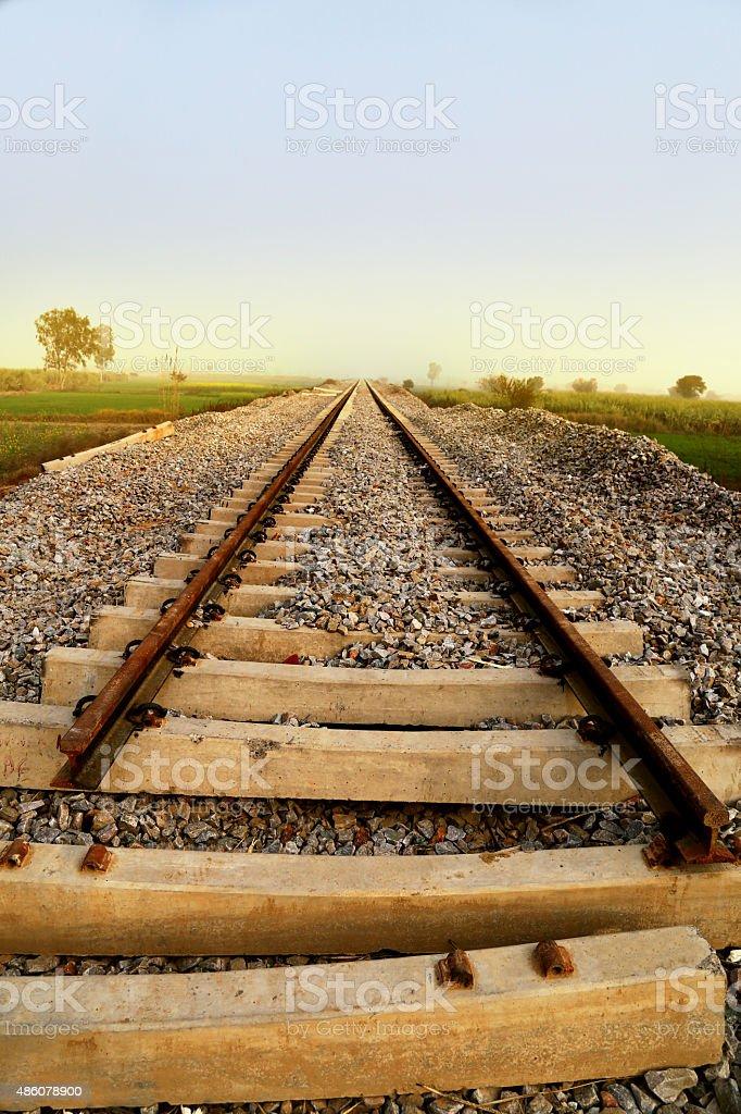 Railway Line Through Field HDR Image stock photo