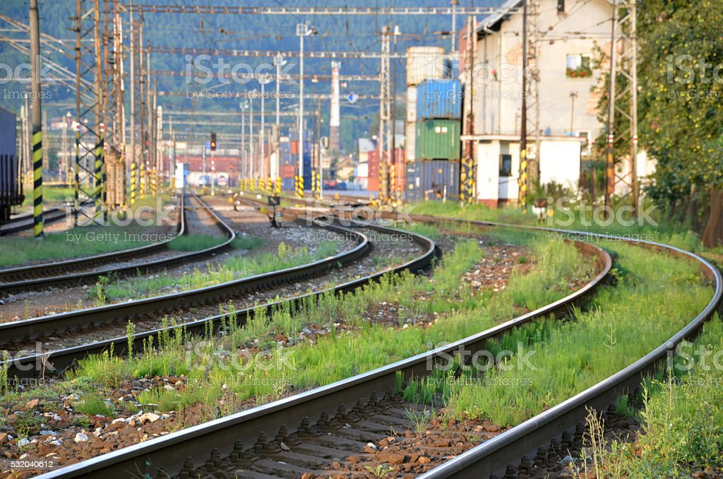 Railway lines leading to container transhipment station stock photo