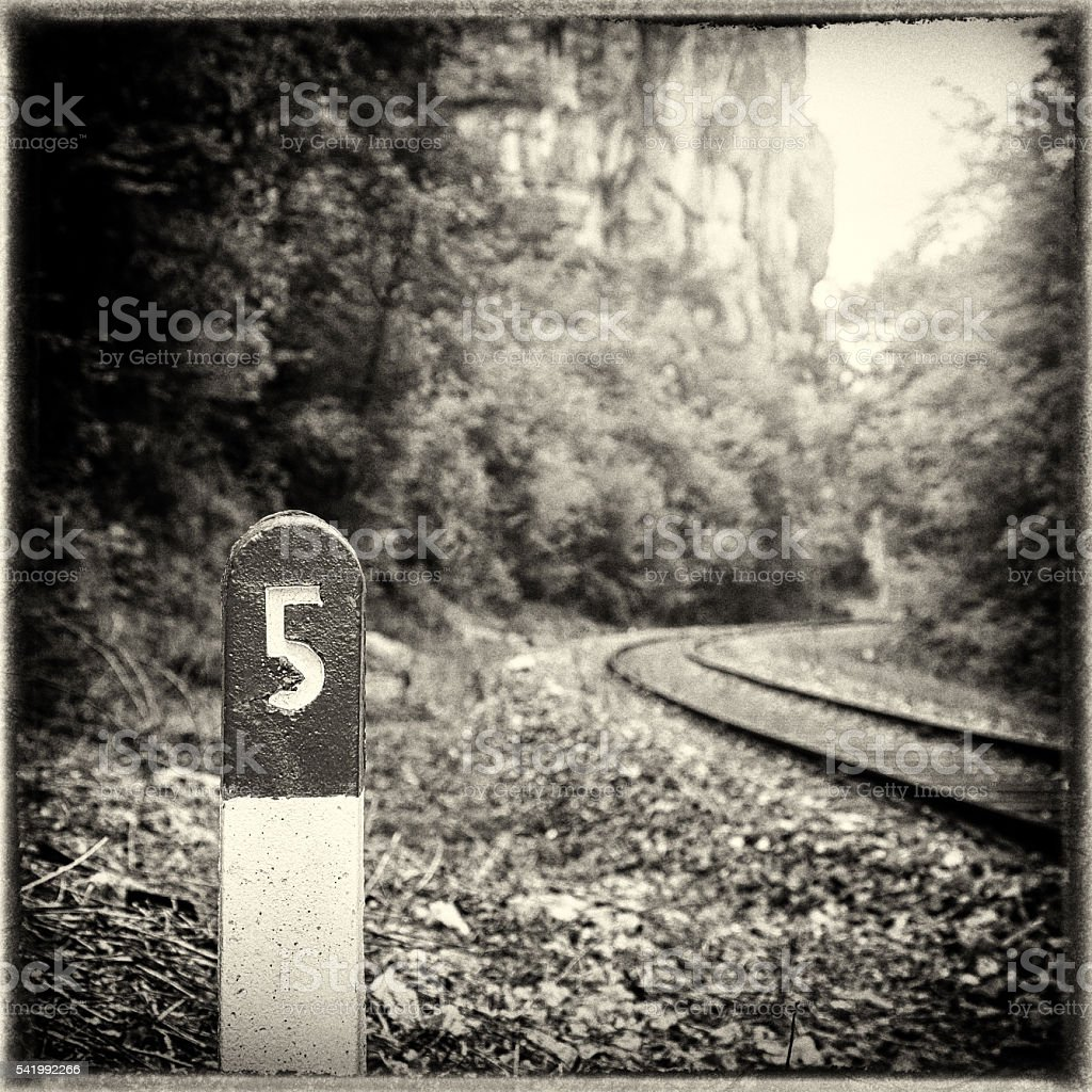 Railway pole sign close-up retro-styled imagery stock photo
