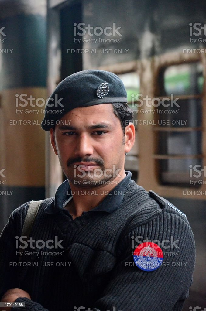 Railway Police officer stands guard at Peshawar train Station Pakistan stock photo