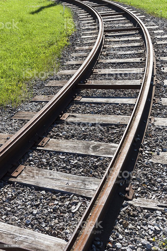 Railway rail road track disappearing around a curve royalty-free stock photo