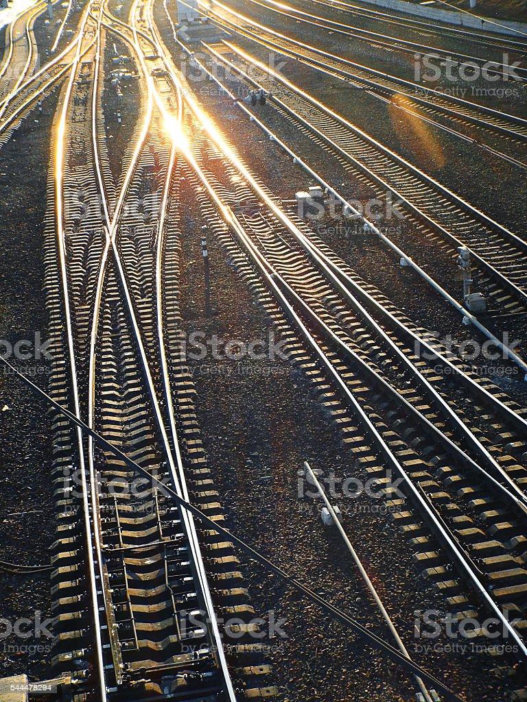 railway rails leaving afar stock photo