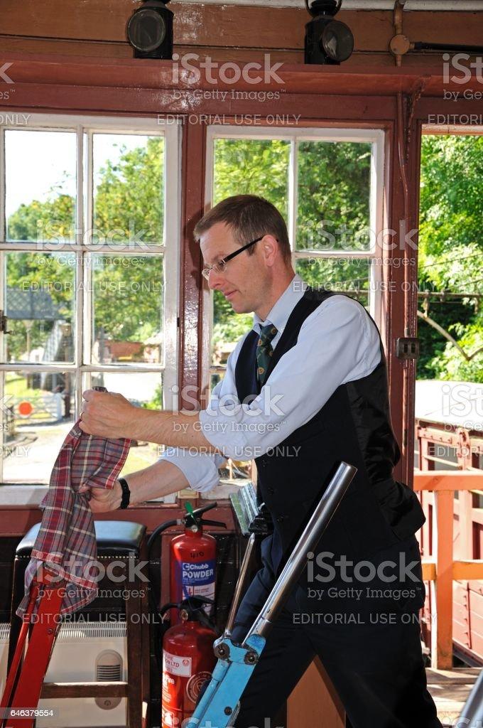 Railway signalman operating line levers, UK. stock photo