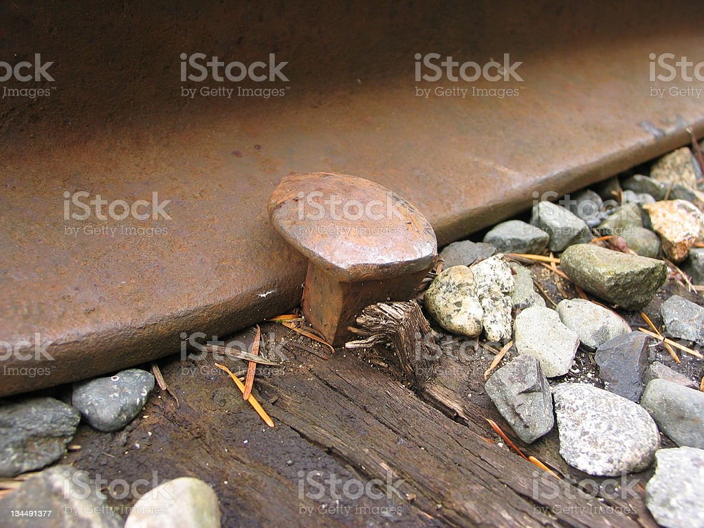 Railway Spike at Work royalty-free stock photo