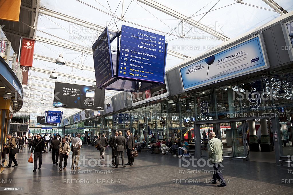 Railway station concourse and information boards stock photo