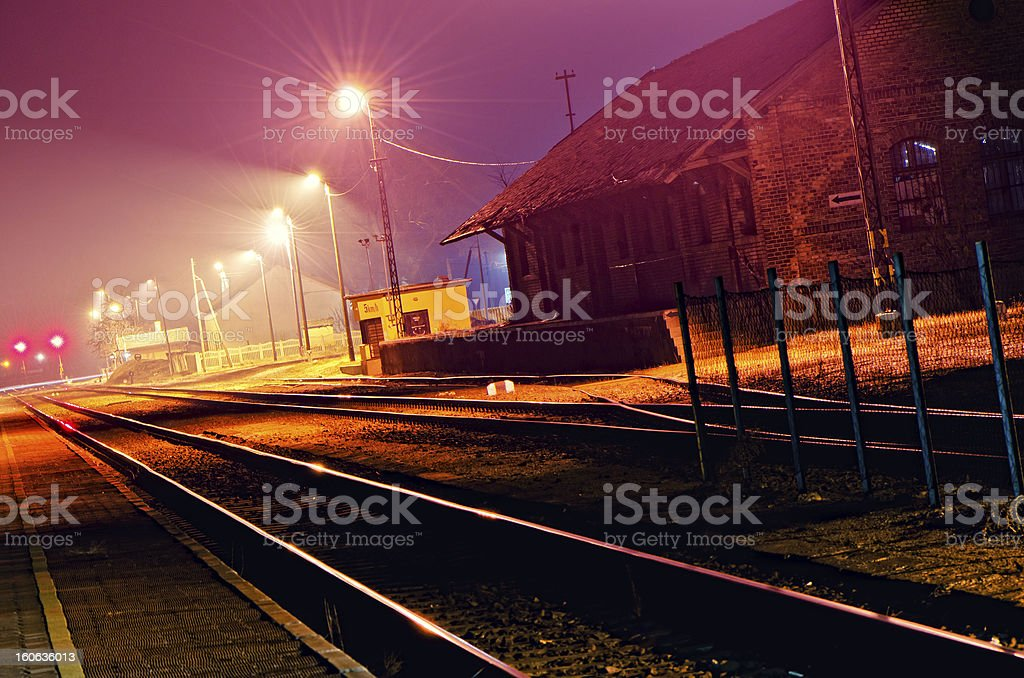 Railway station in the night stock photo